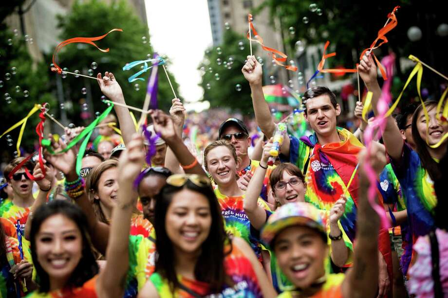 Thousand of onlookers took part in and watched the 41st annual Pride Parade, photographed Sunday, June 28, 2015, in Seattle, Washington. Last Friday, the Supreme Court ruled a 5-to-4 vote that the Constitution guarantees a right to same-sex marriage. Photo: JORDAN STEAD, SEATTLEPI.COM / SEATTLEPI.COM