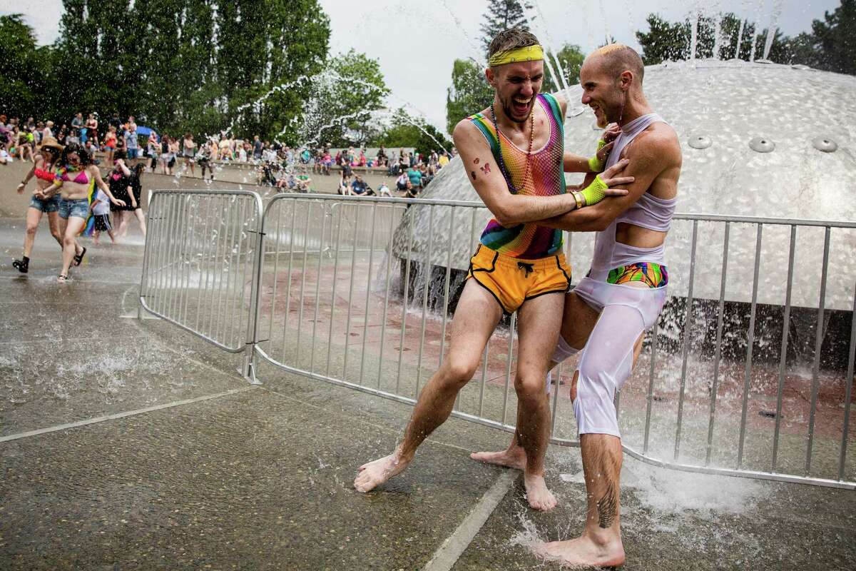 2015: Men play in the International Fountain following the 41st annual Pride Parade, photographed Sunday, June 28, 2015, in Seattle, Washington. Last Friday, the Supreme Court ruled a 5-to-4 vote that the Constitution guarantees a right to same-sex marriage.