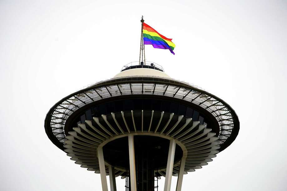 An oversized, rainbow flag flies from the Space Needle during the 41st annual Pride Parade, photographed Sunday, June 28, 2015, in Seattle. Photo: JORDAN STEAD, SEATTLEPI.COM / SEATTLEPI.COM