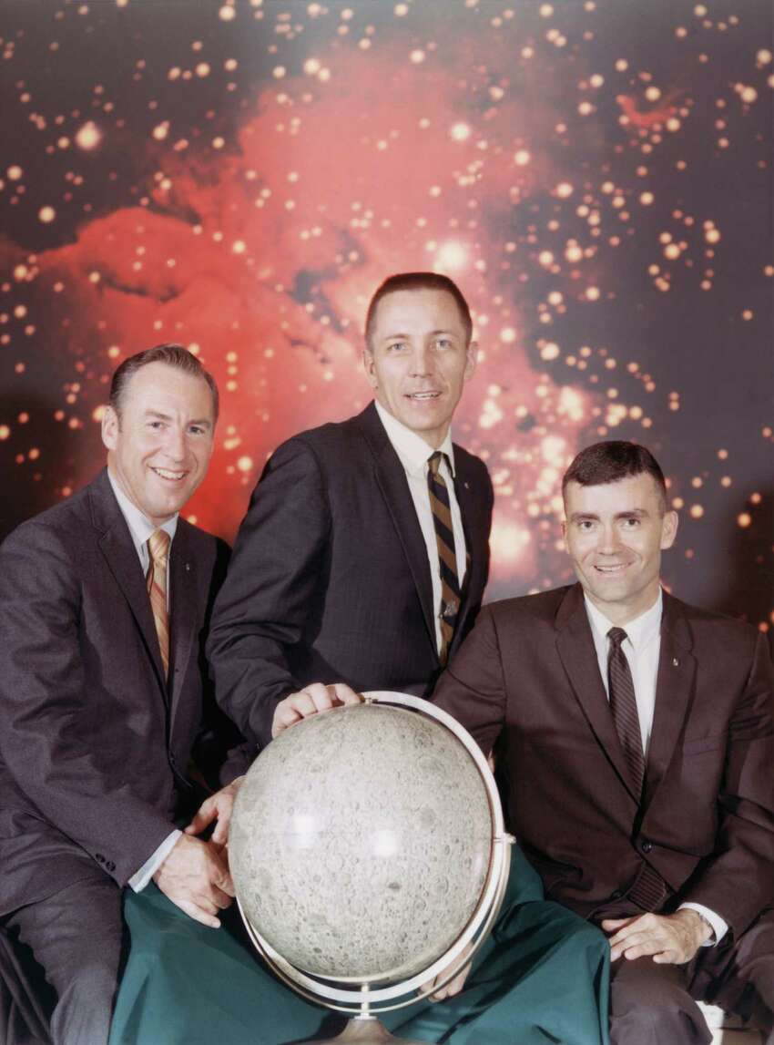 Here's the real-life Apollo 13 crew taken shortly before liftoff: from left to right, Commander James A. Lovell Jr., Command Module pilot John L. Swigert, Jr. and Lunar Module pilot Fred W. Haise, Jr., April 1970. The mission was launched on April 11th, 1970, but the crew were forced to return to earth without ever having reached the moon, following an onboard explosion.