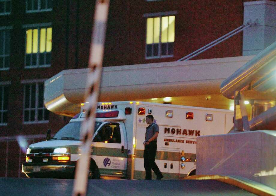 An ambulance transporting prison escapee David Sweat arrives at Albany Medical Center on Sunday, June 28, 2015, in Albany, N.Y.  Sweat was shot earlier in the day by a law enforcement officer near the Canadian border.  (Paul Buckowski / Times Union) Photo: PAUL BUCKOWSKI / 00032185A