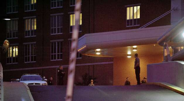 Law enforcement officers stand guard outside the entrance to the emergency room as an ambulance transporting prison escapee David Sweat arrives at Albany Medical Center on Sunday, June 28, 2015, in Albany, N.Y.  Sweat was shot earlier in the day by a law enforcement officer near the Canadian border.  (Paul Buckowski / Times Union) Photo: PAUL BUCKOWSKI / 00032185A