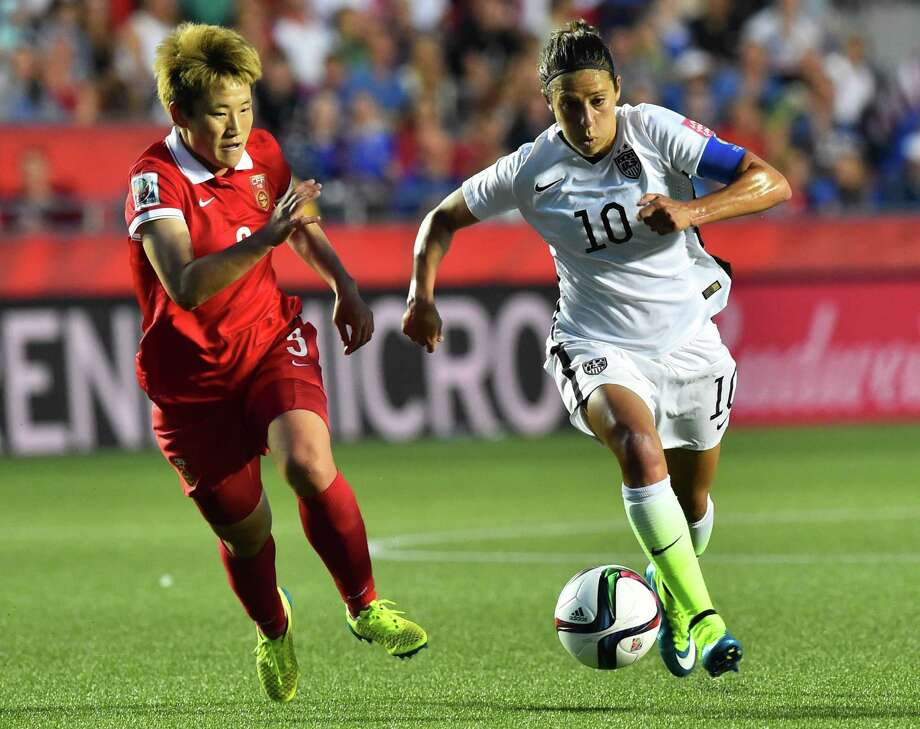 Carli Lloyd, right, was given the freedom to be more creative against China, and it paid off. Photo: NICHOLAS KAMM, Staff / AFP