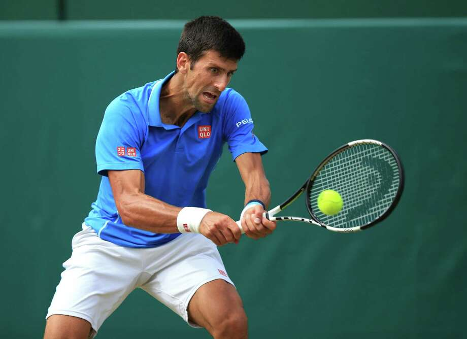 Novak Djokovic in action during his match with Alexander Zverev during day four of The Boodles at Stoke Park, near Stoke Poges, England, Friday June 26, 2015. (Mike Egerton/PA via AP)  UNITED KINGDOM OUT  NO SALES  NO ARCHIVE ORG XMIT: LON812 Photo: Mike Egerton / PA