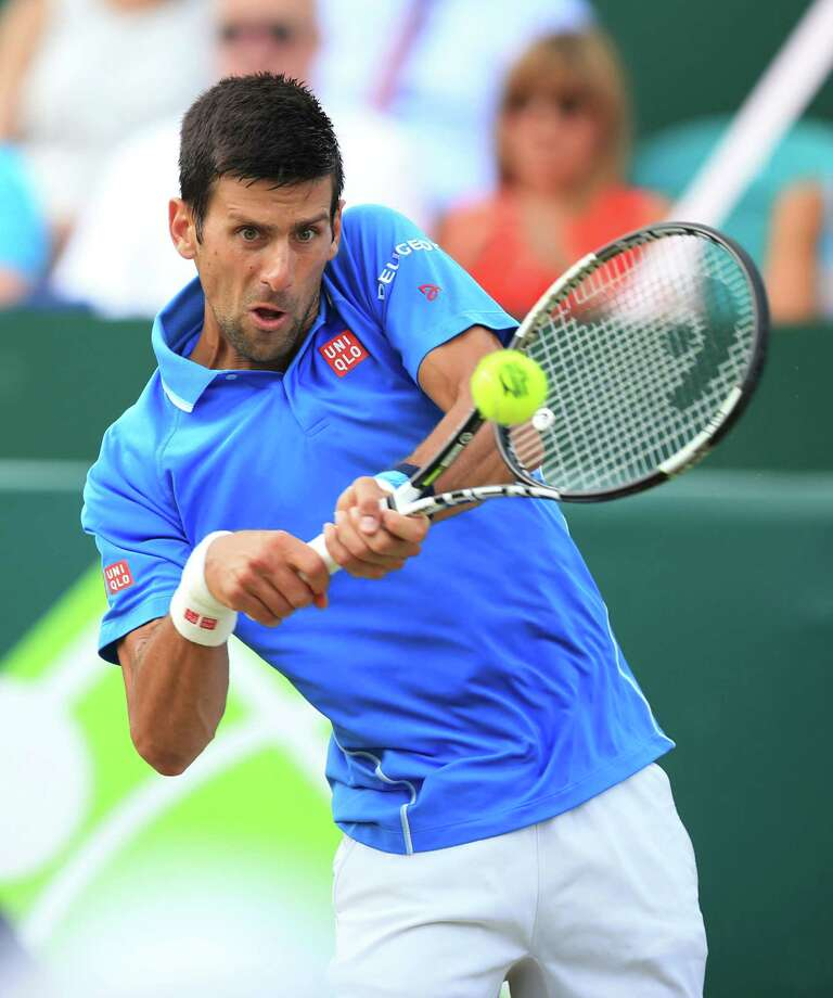Novak Djokovic in action during his match with Alexander Zverev during day four of The Boodles at Stoke Park, near Stoke Poges, England, Friday June 26, 2015. (Mike Egerton/PA via AP)  UNITED KINGDOM OUT  NO SALES  NO ARCHIVE ORG XMIT: LON811 Photo: Mike Egerton / PA