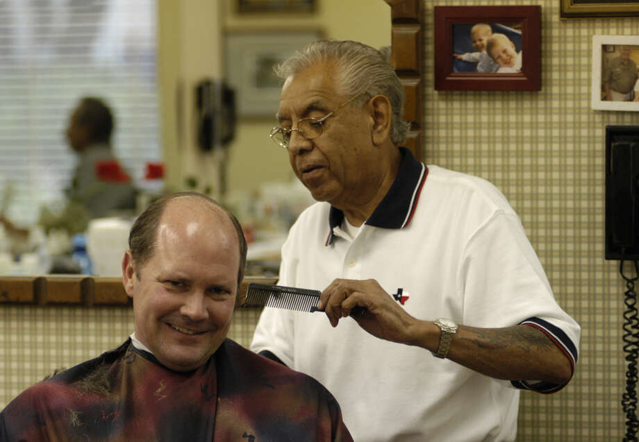 Rudy Rincon works on Walter Bering, a regular at the Avalon Barber Shop, in this 2005 photo. Rincon, who died last week, co-owned the shop for 45 years. Photo: Ben DeSoto, Staff / HOUSTON CHRONICLE