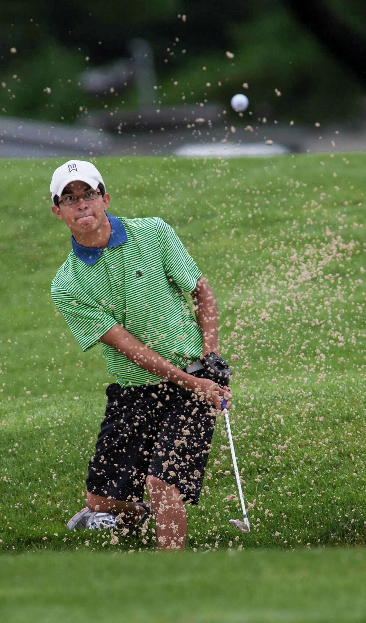 Jason Morilla hits out of a sand trap and onto the fourth hole green during the second round of the Greenwich Town's Men golf Tournament played at Griffith E. Harris Golf Course, Greenwich, CT on Sunday, June 28, 2015.
