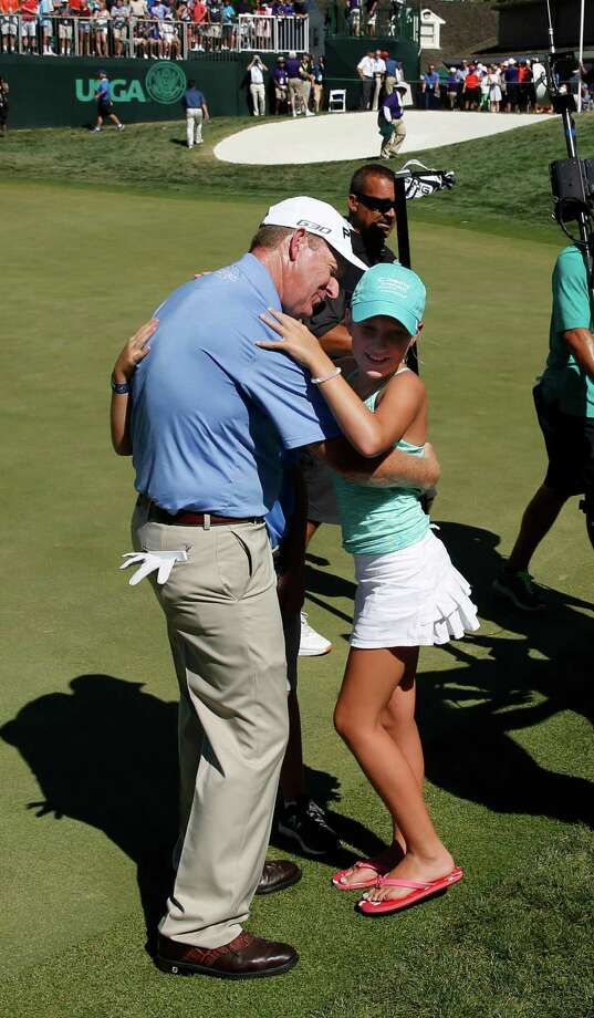 Jeff Maggert enjoys the victory with his 10-year-old daughter Madeline. Photo: Rich Pedroncelli, STF / AP