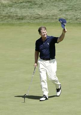 Tom Watson waves to the crowd after making a long birdie putt on the 18th green in the final round of the U.S. Senior Open golf tournament at Del Paso Country Club in Sacramento, Calif., Sunday, June 28, 2015.  Watson finished the tournament five strokes behind winner Jeff Maggert. who finished with a 10-under par 270.(AP Photo/Rich Pedroncelli)