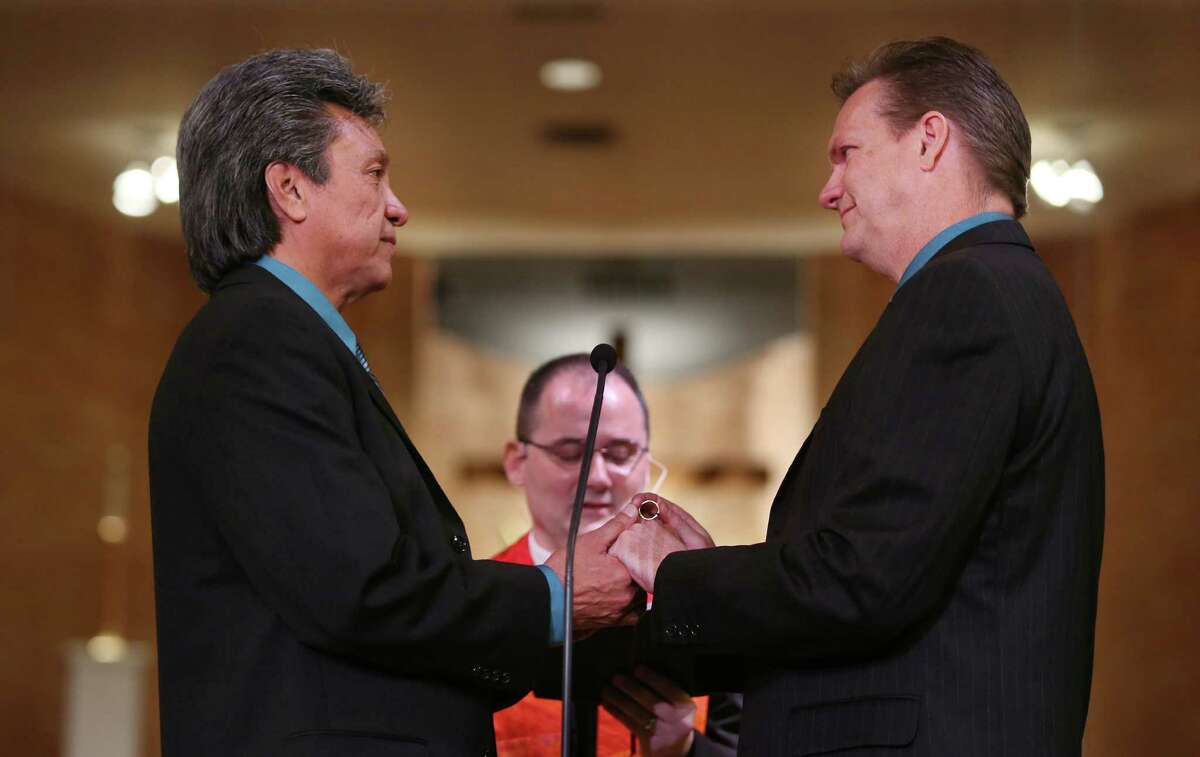 Robert Martinez and Joe Goins are the first couple to be married at Resurrection Metropolitan Community Church in Houston, on the first Sunday after the Supreme Court ruled in favor of same-sex marriage nationwide.