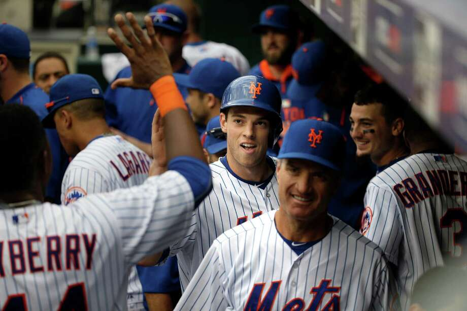 New York Mets' Steven Matz, center, is greeting in the dugout at the end of the sixth inning of a baseball game against the Cincinnati Reds at Citi Field, Sunday, June 28, 2015, in New York. (AP Photo/Seth Wenig) ORG XMIT: NYSW122 Photo: Seth Wenig / AP