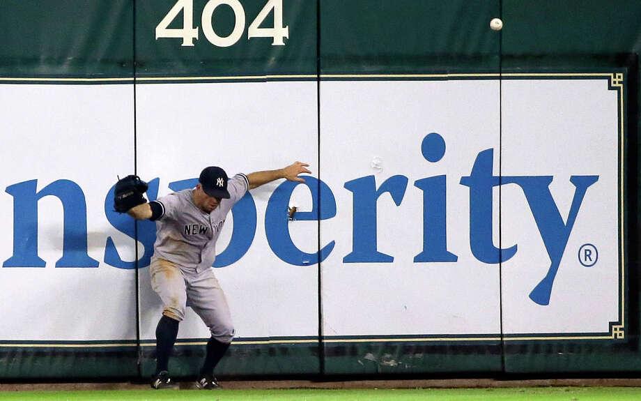 New York Yankees center fielder Brett Gardner chases an RBI-triple hit by Houston Astros' Evan Gattis during the seventh inning of a baseball game Sunday, June 28, 2015, in Houston. (AP Photo/David J. Phillip) ORG XMIT: TXDP121 Photo: David J. Phillip / AP