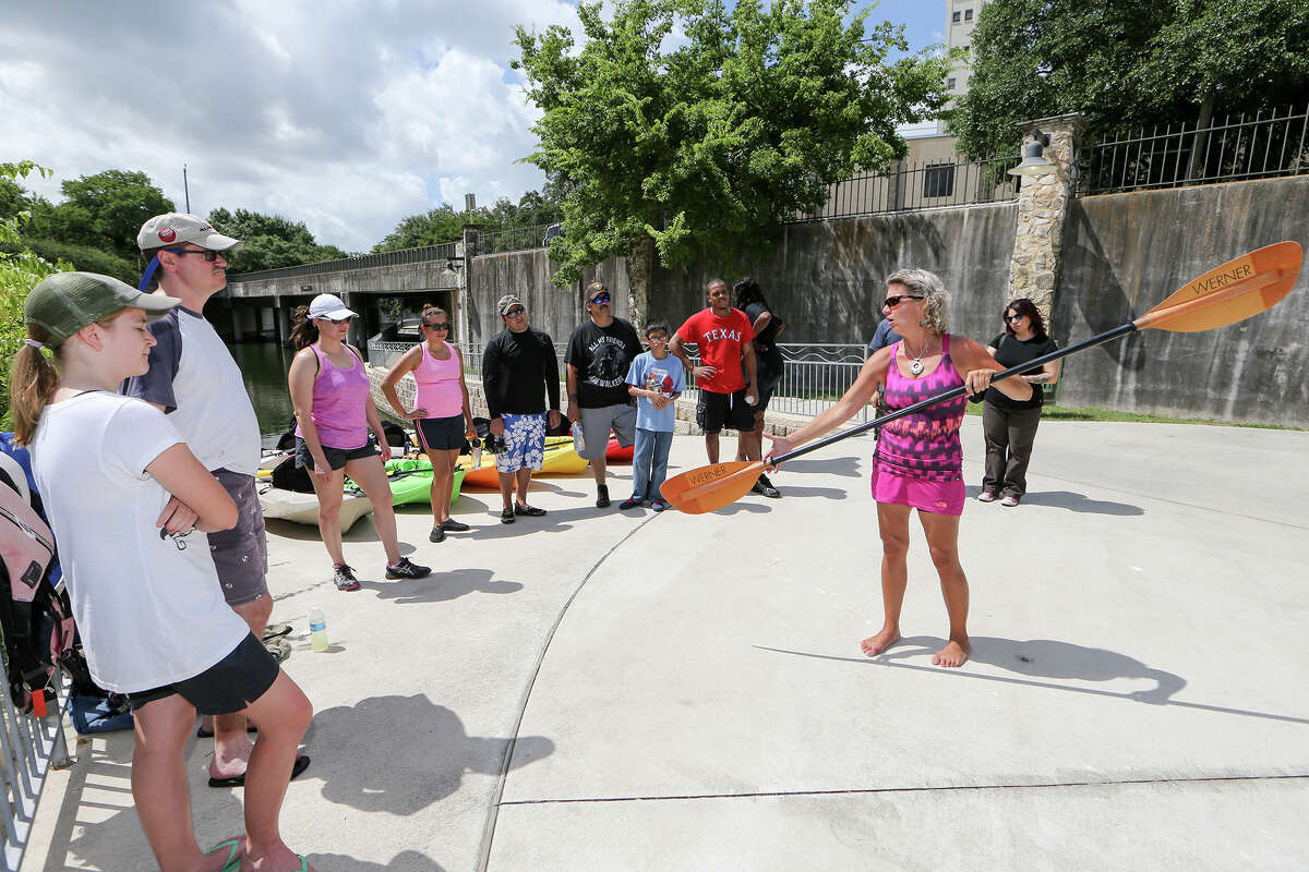Stacey Banta, a certified kayak instructor with Texas Pack and Paddle, teaches proper handling of a paddle for a guided tour on the San Antonio River. The number of kayakers, paddle boarders and canoeists on the river and San Pedro Creek has been rising.