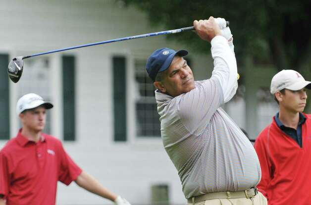 Golfer Dan Russo watches his drive after hitting off the first green in the Troy Invitational golf tournament on Sunday, June 28, 2015, in Troy, N.Y.   (Paul Buckowski / Times Union) Photo: PAUL BUCKOWSKI / 00031821A