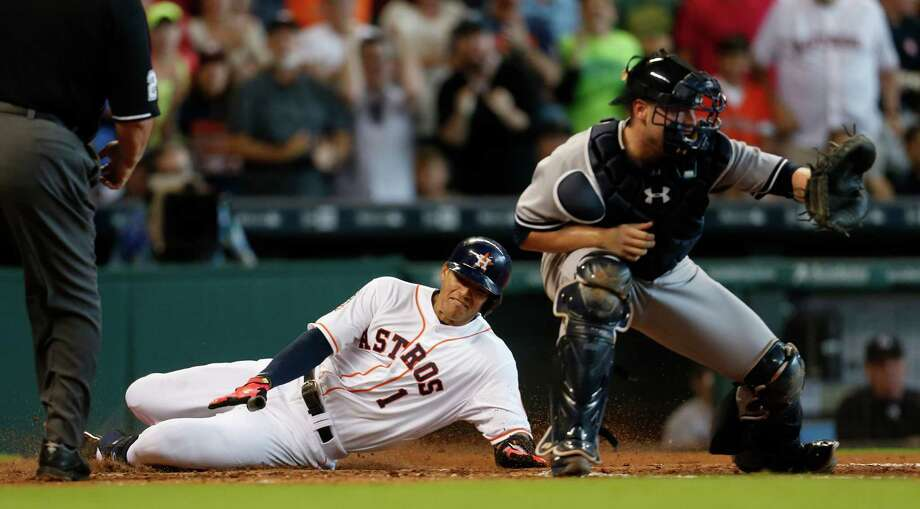 The excitement generated by shortstop Carlos Correa was on display Sunday as he scored after a tour of the bases in the fourth inning when his double was misplayed and he never stopped running. Correa gives thanks, below, after another double in the seventh inning, but it's the Astros who are counting their blessings that the rookie is on their side. Photo: Karen Warren, Staff / © 2015 Houston Chronicle
