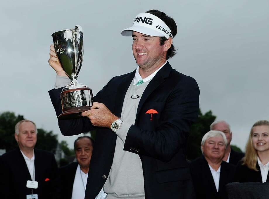 Bubba Watson holds the championship trophy after winning the Travelers Championship golf tournament, Sunday, June 28, 2015, in Cromwell, Conn.  Watson beat out Paul Casey in a playoff. (AP Photo/Jessica Hill) ORG XMIT: CTJH111 Photo: Jessica Hill / FR125654 AP