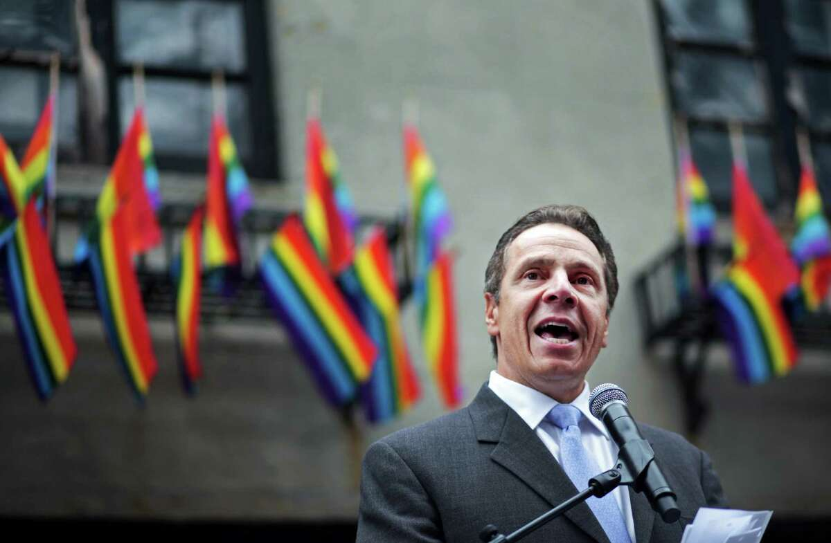 NEW YORK - JUNE 28: New York Governor Andrew Cuomo prepares to officiate the wedding of David Contreras Turley and Peter Thiede before the Gay Pride Parade on June 28, 2015 in New York City. The parade runs two days after the Supreme Court's landmark decision guaranteeing nationwide gay marriage rights. (Photo by Yana Paskova/Getty Images) ORG XMIT: 561717935