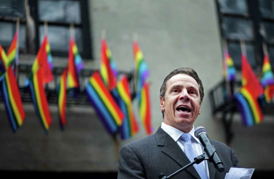 NEW YORK - JUNE 28: New York Governor Andrew Cuomo prepares to officiate the wedding of David Contreras Turley and Peter Thiede before the Gay Pride Parade on June 28, 2015 in New York City. The parade runs two days after the Supreme Court's landmark decision guaranteeing nationwide gay marriage rights. (Photo by Yana Paskova/Getty Images) ORG XMIT: 561717935 Photo: Yana Paskova / 2015 Getty Images