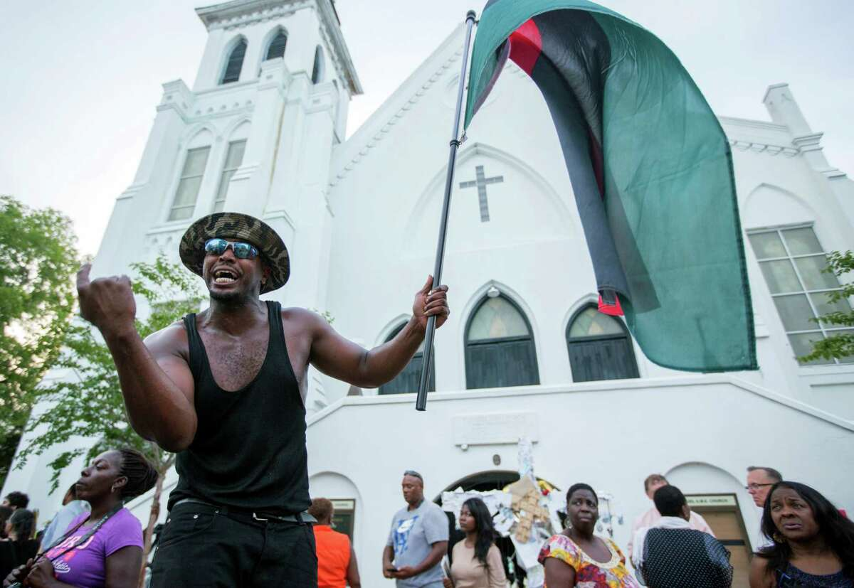 A man yells in front of the Emanuel AME Church during a march down Calhoun Street on Tuesday, June 23, 2015. The march comes six days after a gunman shot nine people during bible study inside the church.