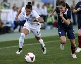 FILE - In this March 11, 2015, file photo, the United States' Ali Krieger, left, battles for the ball with France's Laura Boulleau during the women's soccer Algarve Cup final match at the Algarve stadium, outside Faro, southern Portugal. In broadcasting the Women's World Cup, Fox executives are thrilled for the chance to potentially see the favored U.S. team make a run to the title. But what can really draw in viewers is the realization that the Americans could lose. (AP Photo/Francisco Seco, File)
