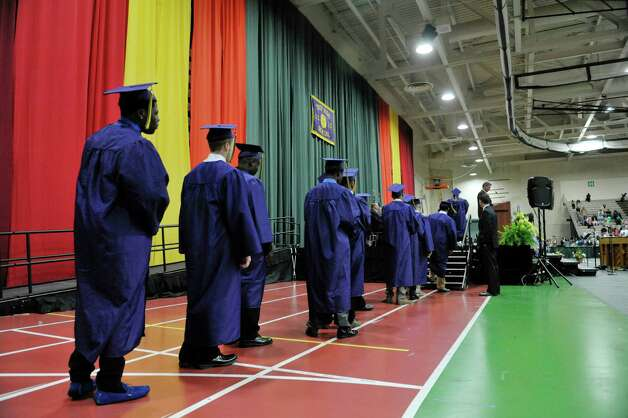 Graduates walk up to receive their diplomas during the Troy High School graduation at Hudson Valley Community College, on Sunday, June 28, 2015, in Troy, N.Y.  (Paul Buckowski / Times Union) Photo: PAUL BUCKOWSKI / 00032185A
