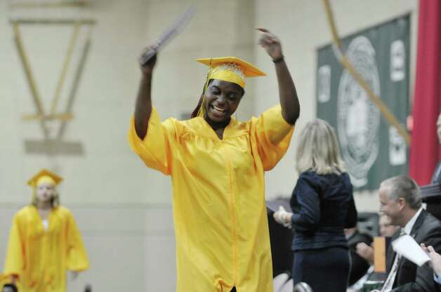 Graduate Kayla Robertson celebrates after receiving her diploma at the Troy High School graduation at Hudson Valley Community College, on Sunday, June 28, 2015, in Troy, N.Y.  (Paul Buckowski / Times Union) Photo: PAUL BUCKOWSKI / 00032185A