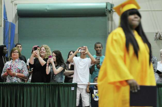 Family and friends cheer on the graduates at the Troy High School graduation at Hudson Valley Community College, on Sunday, June 28, 2015, in Troy, N.Y.  (Paul Buckowski / Times Union) Photo: PAUL BUCKOWSKI / 00032185A