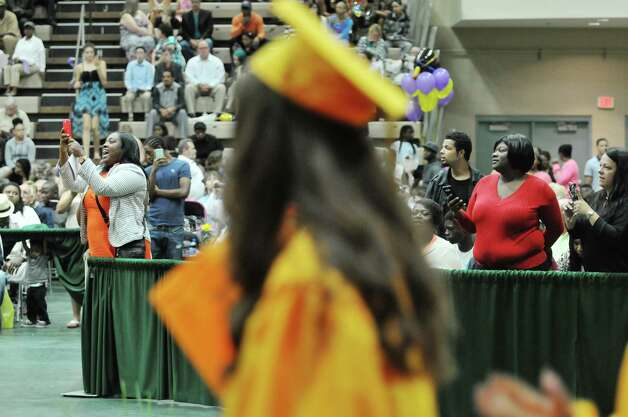Family and friends look to get photographs of the graduates at the Troy High School graduation at Hudson Valley Community College, on Sunday, June 28, 2015, in Troy, N.Y.  (Paul Buckowski / Times Union) Photo: PAUL BUCKOWSKI / 00032185A