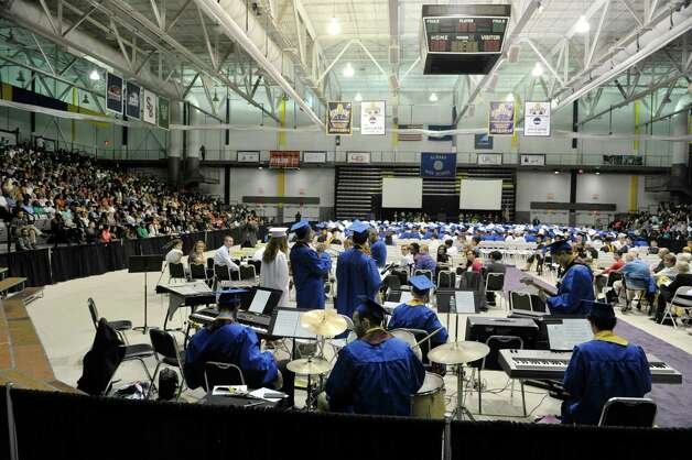 """Graduates and members of the school's Jazz Ensemble, perform the song """"Mercy, Mercy, Mercy"""" at the Albany High School graduation at the SEFCU Arena on the campus of the University at Albany, on Sunday, June 28, 2015, in Albany, N.Y.  (Paul Buckowski / Times Union) Photo: PAUL BUCKOWSKI / 00032184A"""