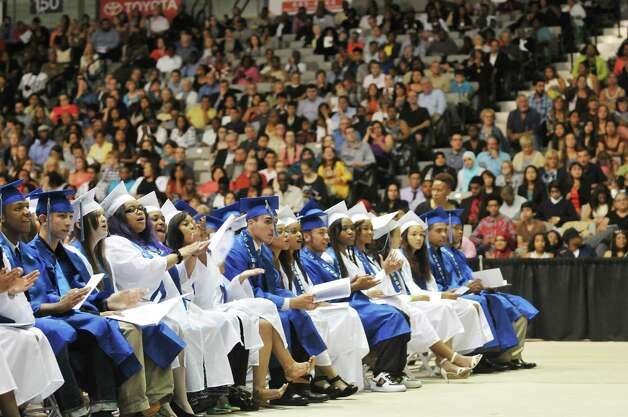Graduates cheer their fellow graduates at the Albany High School graduation at the SEFCU Arena on the campus of the University at Albany, on Sunday, June 28, 2015, in Albany, N.Y.  (Paul Buckowski / Times Union) Photo: PAUL BUCKOWSKI / 00032184A