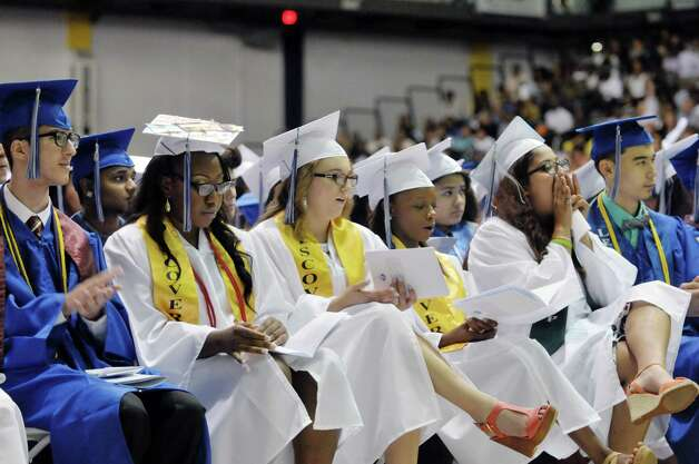 Graduates listen to a speaker at the Albany High School graduation at the SEFCU Arena on the campus of the University at Albany, on Sunday, June 28, 2015, in Albany, N.Y.  (Paul Buckowski / Times Union) Photo: PAUL BUCKOWSKI / 00032184A