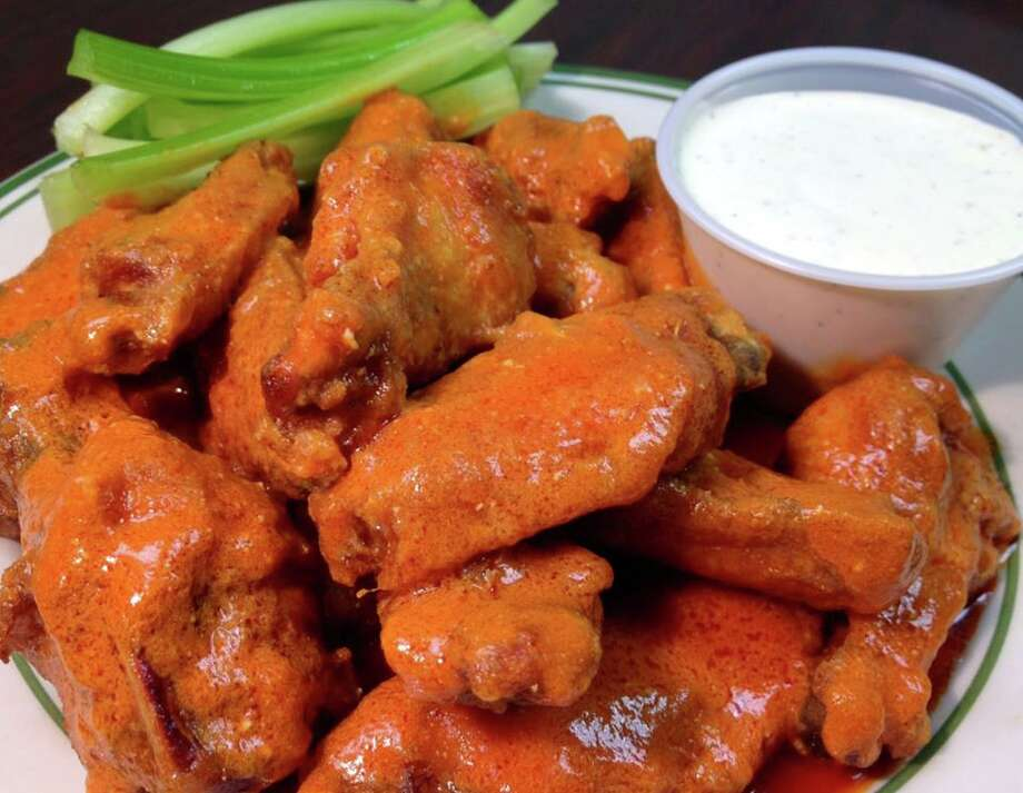 Archie Moore's offers wings, nachos, burgers, wraps, and more... perfect 4th of July fixins!  Locations in Milford, Derby, Fairfield, New Haven, and Wallingford. Photo: Ctbites