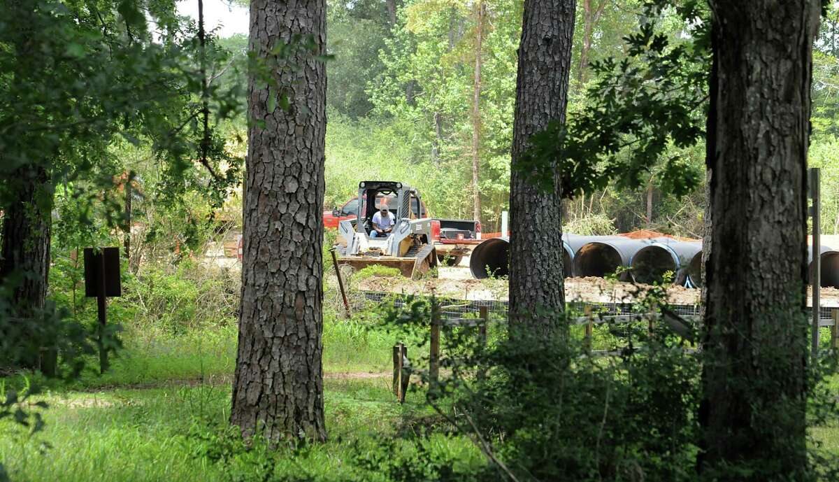 Construction on an apartment complex next to W.G. Jones State Forest, in foreground, at F.M. 1488 is underway with ground work being done. Photograph by David Hopper.