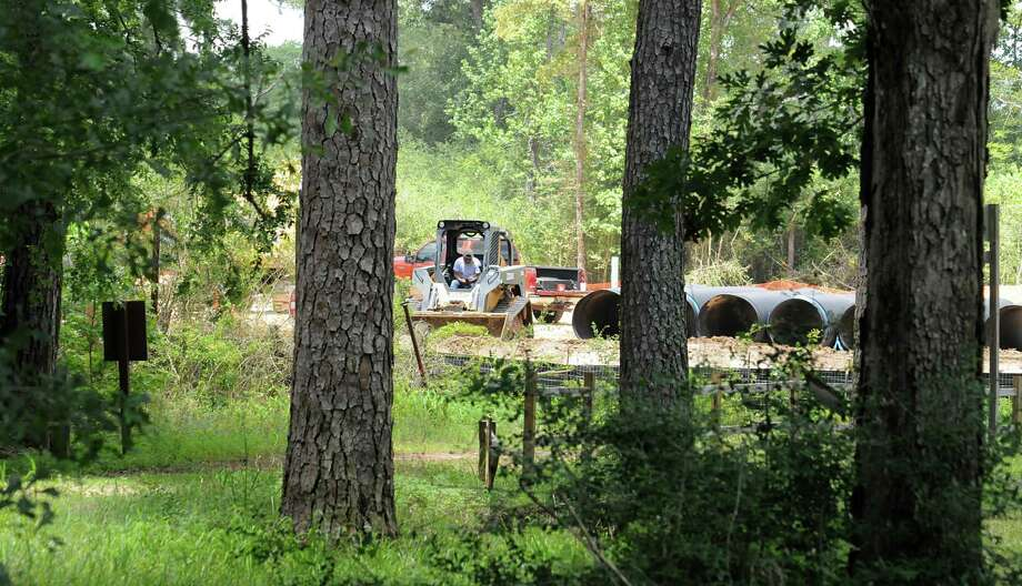 Construction on an apartment complex next to W.G. Jones State Forest, in foreground, at F.M. 1488 is underway with ground work being done. Photograph by David Hopper. Photo: David Hopper, Freelance / freelance