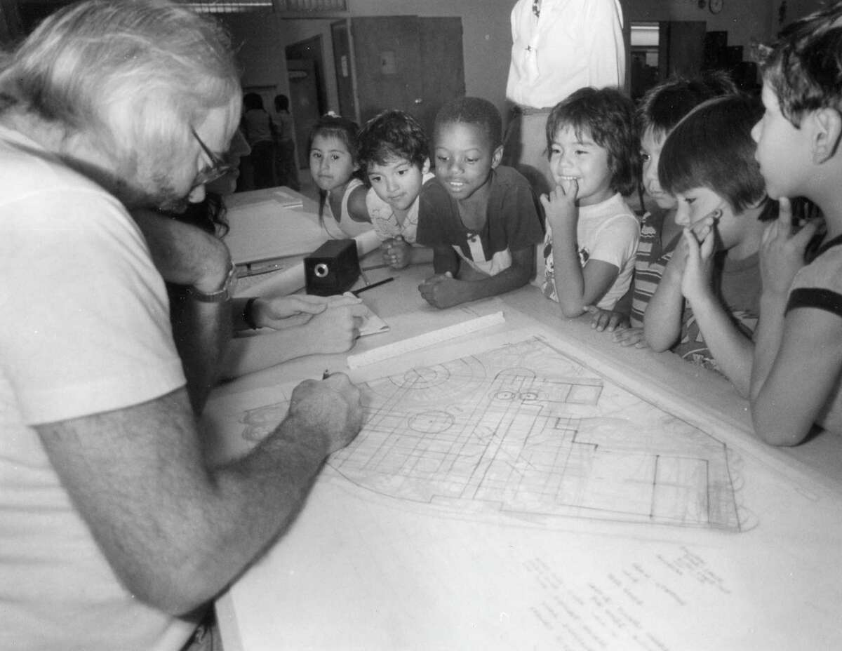 Kindergartners meet with playground architect Robert Leather to discuss designs for HemisFair Park, October 26, 1988.