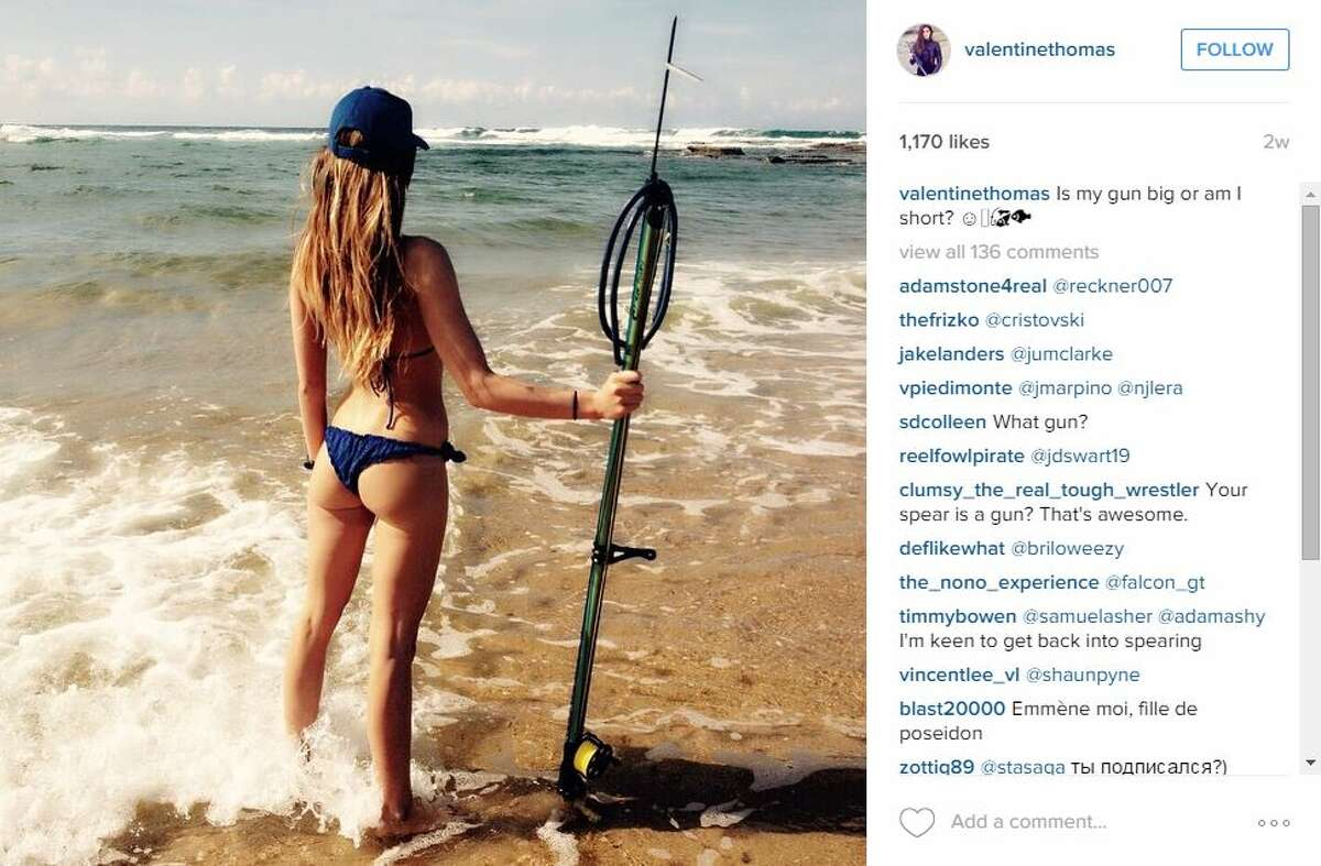 Valentine Thomas, a world record holding spearfisher, pushes for sea preservation clad in a bikini, or a wet suit.