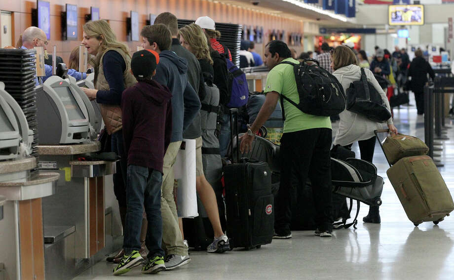 With one of the city's largest-ever conventions set to start this week, the airport is recommending that travelers arrive two hours before their scheduled flight, print boarding passes before they arrive or print boarding passes at an airport kiosk. Photo: John Davenport /San Antonio Express-News / ©San Antonio Express-News/John Davenport