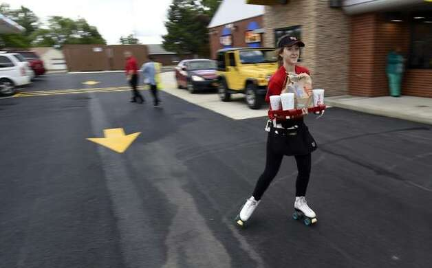 Carhops are hustling to fill orders on a very busy day at the new Sonic during their soft open in Latham, NY, on Monday, June 29, 2015. (Skip Dickstein/Times Union)