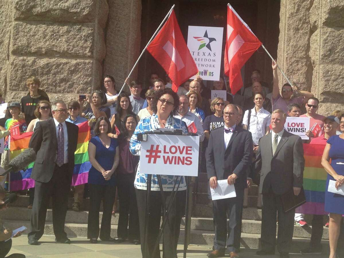 State Rep. Celia Israel, D-Austin, gathers with other Texans on the steps of the state Capitol on Monday, June 29, 2015 to celebrate the U.S. Supreme Court's recent ruling legalizing same-sex marriage.