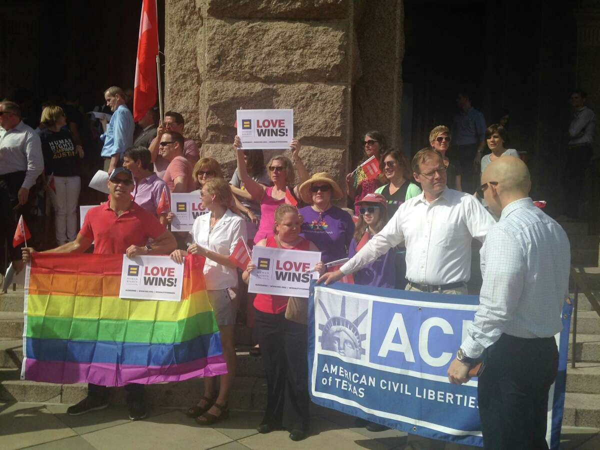 Texans gather on the steps of the state Capitol on Monday, June 29, 2015 to celebrate the U.S. Supreme Court's recent ruling legalizing same-sex marriage.