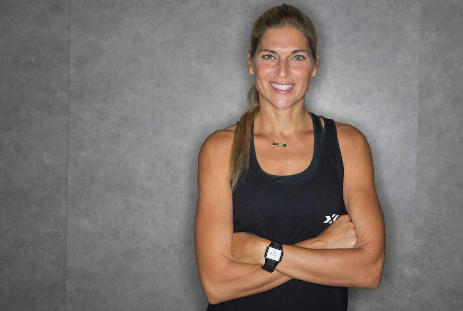 Gabby Reece poses for a portrait before teaching a HIGHX class at the 24 Hour Fitness on Saturday, June 27, 2015 in Pearland, TX. Photo: Thomas B. Shea, For The Chronicle / © 2015Thomas B. Shea