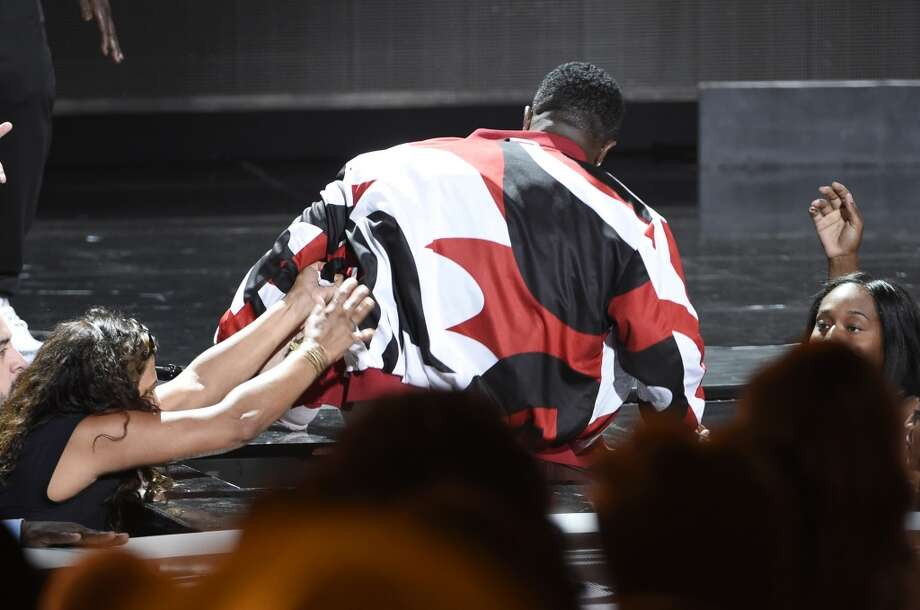 "Sean ""Diddy"" Combs falls while he performs at the BET Awards at the Microsoft Theater on Sunday, June 28, 2015, in Los Angeles. (Photo by Chris Pizzello/Invision/AP) Photo: Associated Press"