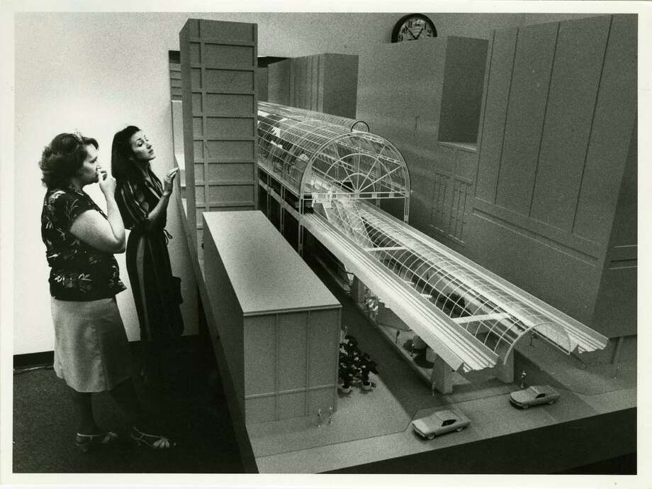 In October 1982, city employees check out models of METRO's proposed elevated light rail train system for Main Street in downtown Houston. Photo: John Everett, Houston Chronicle / Houston Chronicle