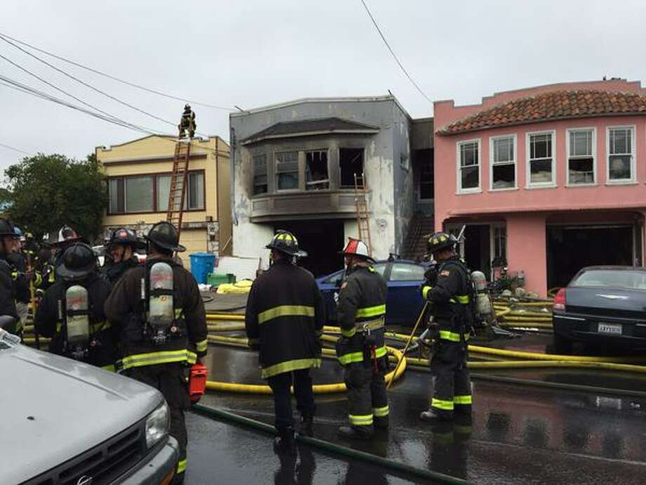 A fire broke out at 1141 Plymouth Ave. in San Francisco on Monday morning. Photo:  Evan Sernoffsky / The Chronicle