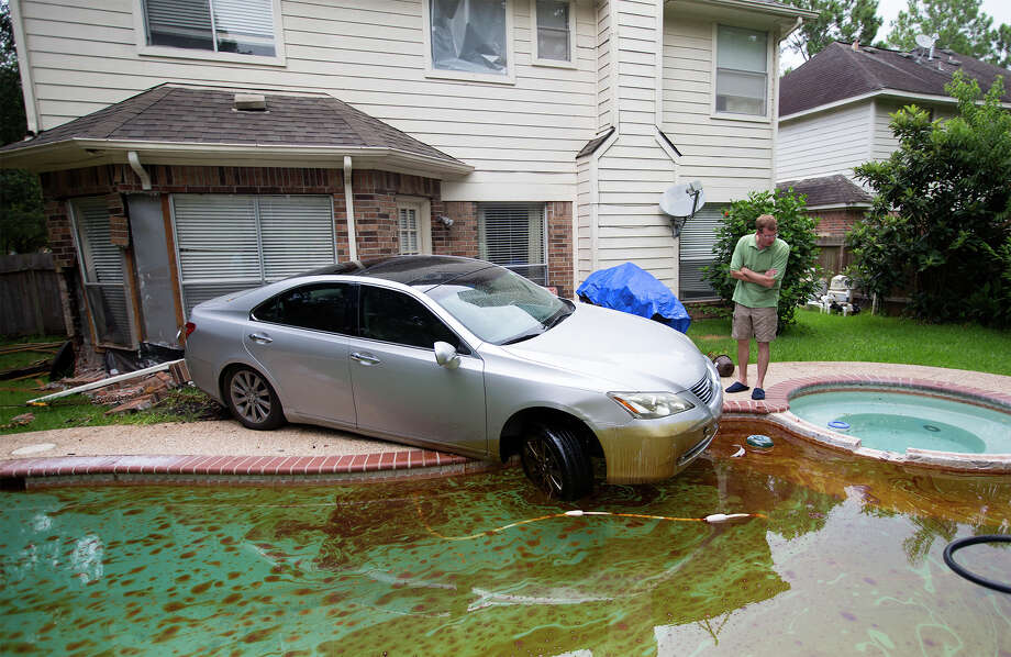John Donnelly stands by a car after it drove into his pool in the 4700 block of Glasgow, Monday, June 29, 2015, in Missouri City. Photo: Cody Duty, Houston Chronicle / © 2015 Houston Chronicle