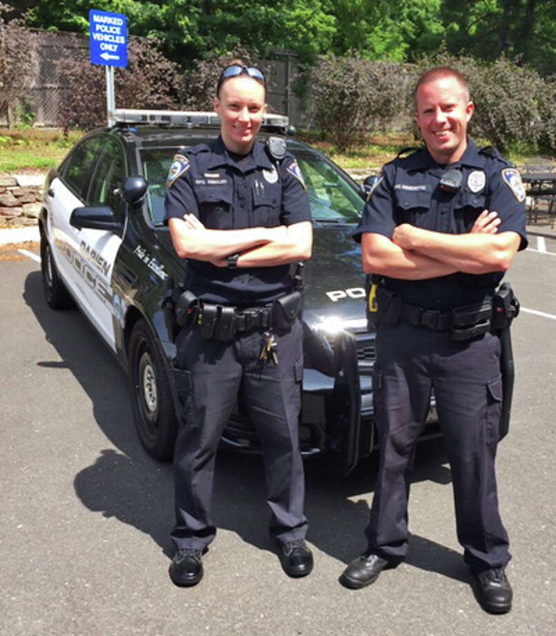 Darien Police Field Training Officer Greg Benedetto, right, with probationary Officer Amanda Hinkley as they prepare for patrol.  Hinkley recently joined the department after graduating from the Connecticut State Police Academy. Photo: Contributed / Contributed Photo / Darien News