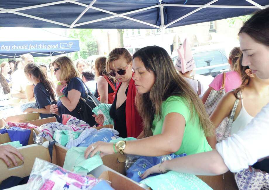 Shoppers during the Greenwich Sidewalk Sale Days in central Greenwich, Conn., Thursday afternoon, July 10, 2014. The 2015 sales event will take place July 9-12, from 10 a.m. to 6 p.m., on Greenwich Avenue and nearby streets downtown. There are more than 140 Greenwich businesses expected to participate. Photo: Bob Luckey / Bob Luckey / Greenwich Time