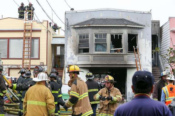 Fire crews respond to the house fire on Plymouth Street, which also affected both neighboring houses in San Francisco on Monday, June 29, 2015.