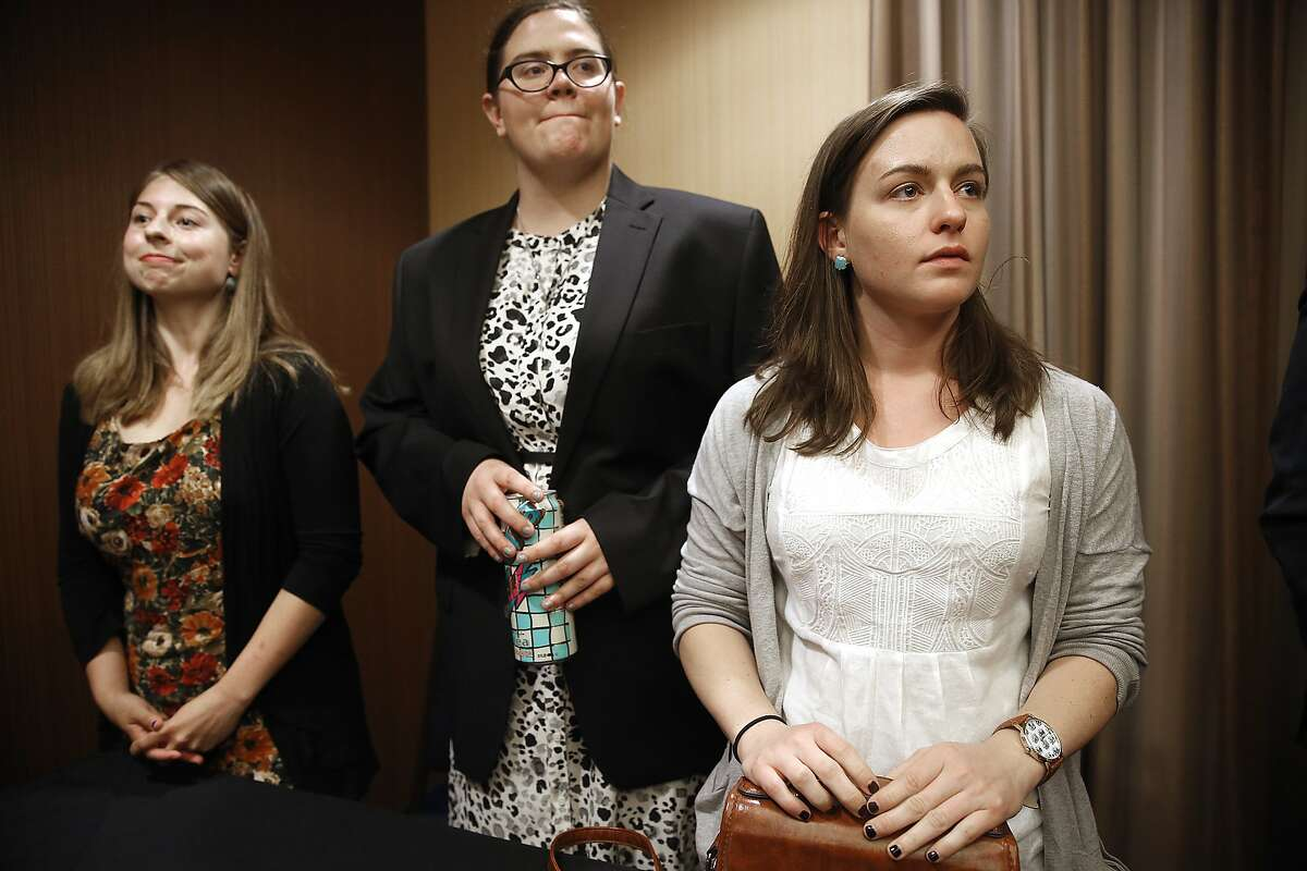 Sofie Karasek (left), 22 years old, Aryle Butler (middle), 21 years old, and Nicolette Commins (right), 23 years old, announce suing the University of California for failing to protect and investigate their complaints of sexual assault when they were students at UC Berkeley at a press conference at Courtyard Marriott in Emeryville, Calif., on Monday, June 29, 2015.