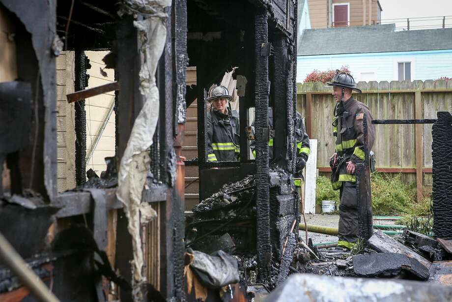 The back of house, where the fire started, shows the immense damage of the house fire on Plymouth Street, which also affected both neighboring houses in San Francisco on Monday, June 29, 2015. Photo: Amy Osborne, Special To The Chronicle